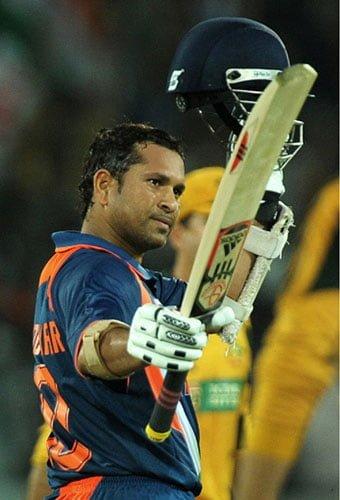 Sachin Tendulkar raises his bat after scoring on eof his magnificent ODI centuries