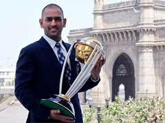 MS Dhoni posing with the ICC World Cup 2011