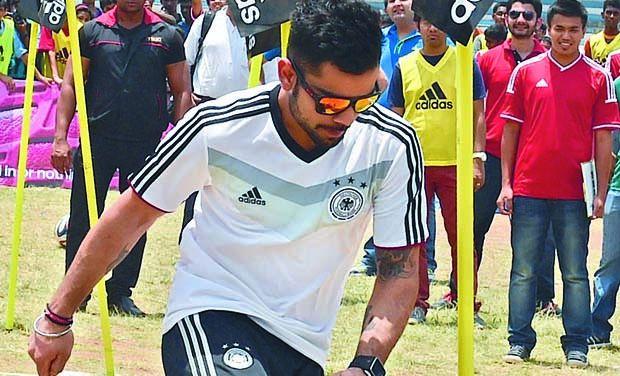 Kohli playing football