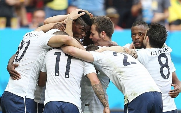 Paul Pogba celebrates with his team-mates after scoring the first goal