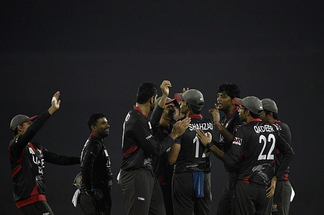 UAE players celebrate after dismissing Sri Lankan players for a megre target of 129 run.